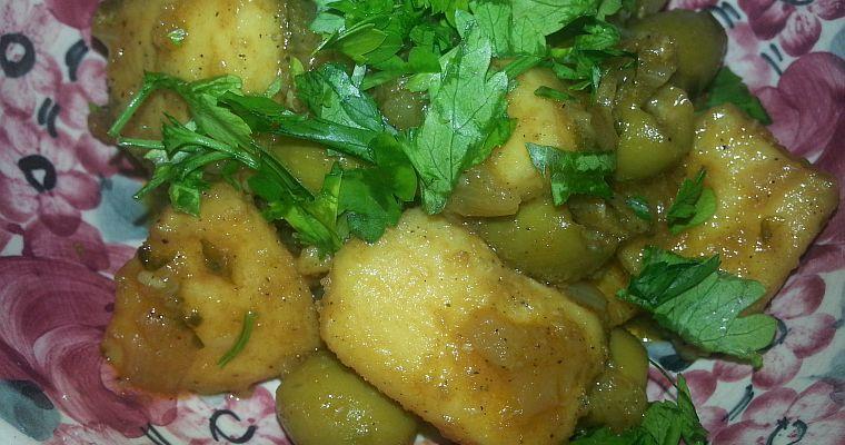 Mątwa z cebulą i oliwkami
